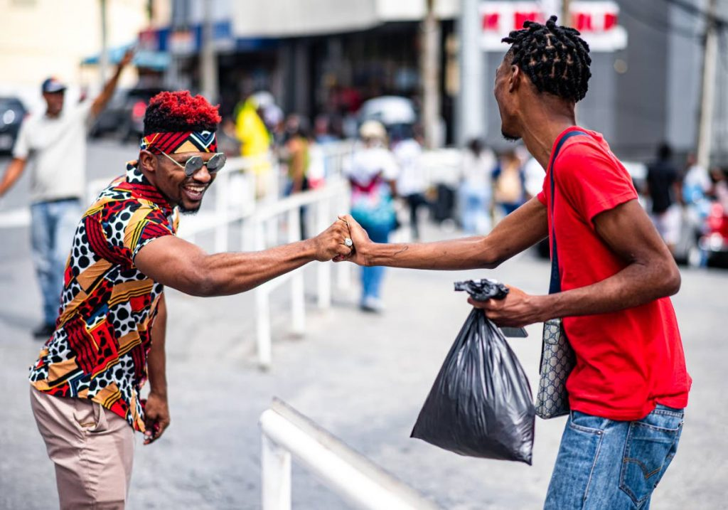 MAIN PHOTO  An episode of What Yuh Know where the show''s creator Daniel Loveless greats a member of the public. Since it began four years ago, the show has gained over 23 million views on YouTube. - Jeremy Bridgenath