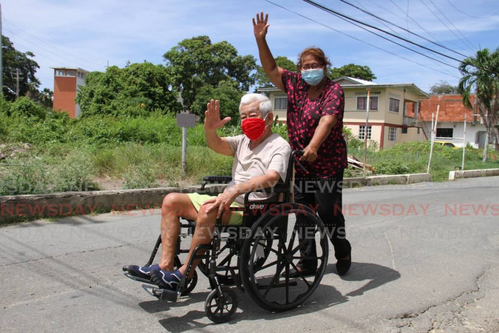 Ingrid Paul takes her 83 year old husband George Chang for a stroll along the Old Milford Road, Tobago while they are on vacation. The couple are from Trinidad.   Photo by Ayanna Kinsale