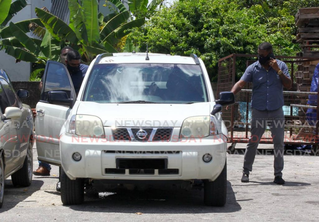 Anti-Kidnapping Unit police arrive in Sangre Grande to investigate the kidnapping of businesswoman Mary Ali.  - ROGER JACOB