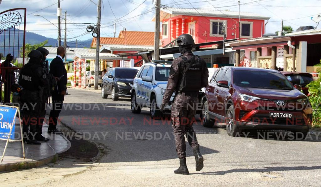 RETURNED: Police returned to the scene in La Horquetta on Wednesday, a day after a raid led to the discovery of $22m in a house believed to be the proceeds of sou-sou scheme. The money has since been returned.  - ROGER JACOB