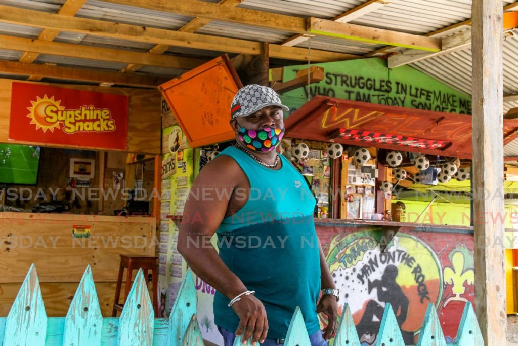 STRESS: Ashley Mc Millan, who owns Man on the Rock Bar at Store Bay in Tobago, is despondent over the lack of sales during Saturday's Great Race event. - Ayanna Kinsale