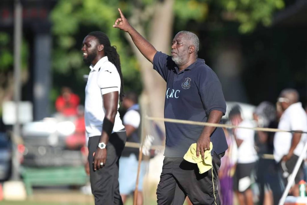 FOND MEMORIES: Former QRC head coach Nigel Grosvenor, right, and assistant coach Kenwyne Jones, left, on the sidelines of a Secondary Schools Football League game in 2018. PHOTO BY CA-IMAGES - CA IMAGES