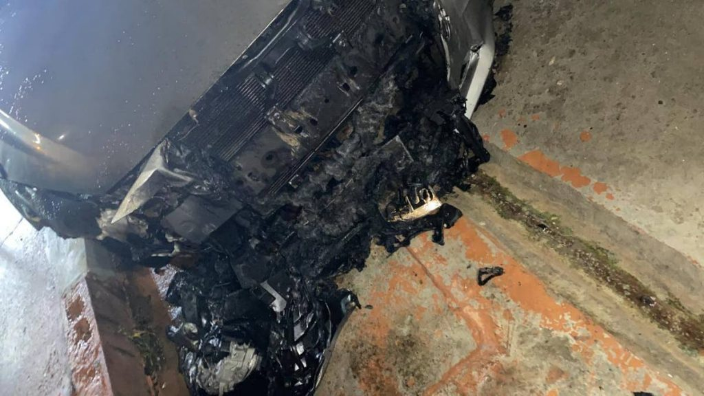The firebombed car at her Ste Madeleine home -