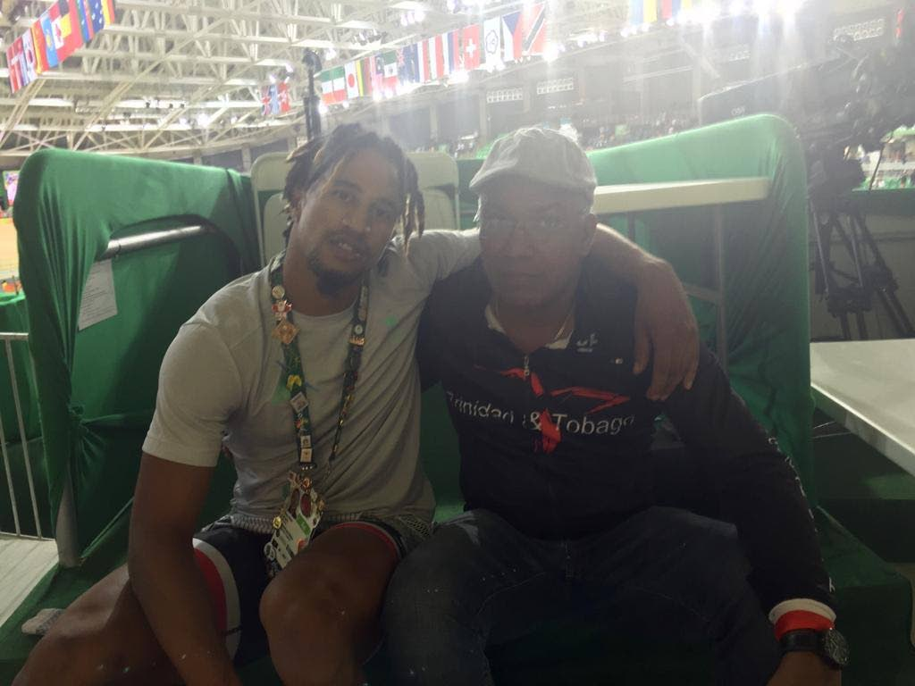 Two-time Olympian Njisane Phillip, left, with his stepfather Phillip Whiteman at a 2019 Olympic qualifier event. -
