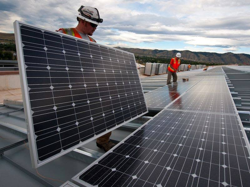 Solar panels being installed. -