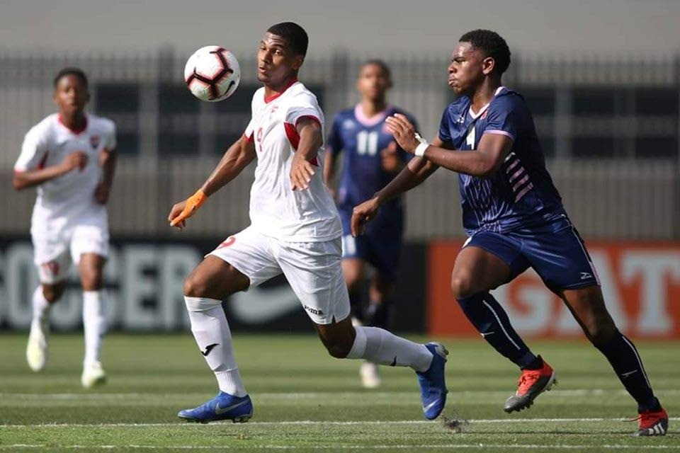 TT's Justin Araujo-Wilson (centre) in action against Bermuda during a 2019 CONCACAF Under-17 World Cup qualifying match. PHOTO COURTESY CONCACAF. -