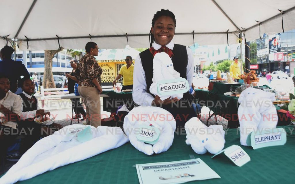 In this 2019 file photo, Abiah Smith from the Beetham Servol Life Centre shows some of her housekeeping towel animals during a Servol Career Fair on the Brain Lara Promenade, Port of Spain.
