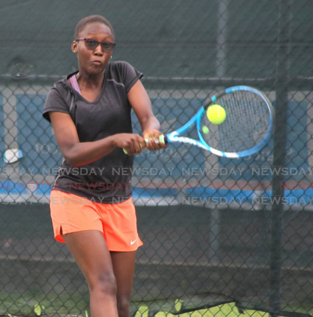 Maria Honore attempts to play a shot at the Sagicor Junior Tennis tournament, Trinidad Country Club, Maraval, in 2019. Deyalsingh said on Saturday that tennis is allowed to continue at a covid19 briefing. PHOTO BY ROGER JACOB    Sagicor Junior Tennis Tournament 2019, Trinidad Country Club, Maraval. - ROGER JACOB