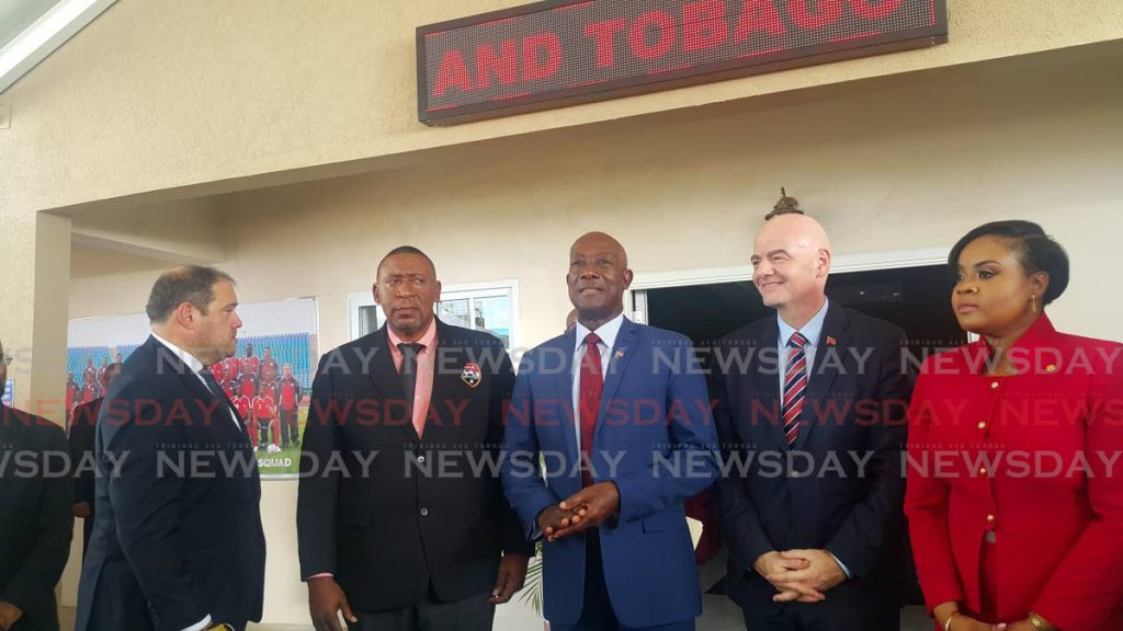 In this November 18, 2019, from left to right, CONCACAF president Victor Montagliani, TTFA president David John-Williams, PM Dr Keith Rowley, FIFA president Gianni Infantino and Sport Minister Shamfa Cudjoe at the opening of the Home of Football, Couva. PHOTO BY NARISSA FRASER - Narissa Fraser
