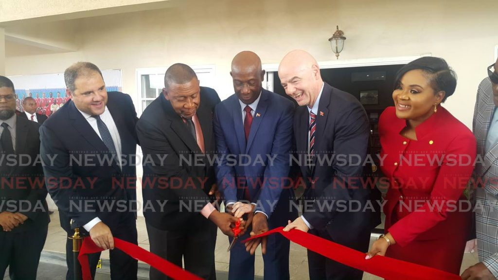 (From left to right) In this Nov 18, 2019 file photo, Concacaf president Victor Montagliani, former TTFA president David John-Williams, PM Dr Keith Rowley, FIFA president Gianni Infantino, and Sport minister Shamfa Cudjoe cut the ribbon at the opening of the Home of Football,in Couva. PHOTO BY NARISSA FRASER -