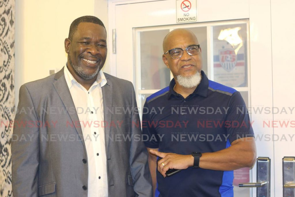 FILE PHOTO: United TTFA members William Wallace, left, and Keith Look Loy, right, smile after Wallace was voted TTFA president in November last year.
