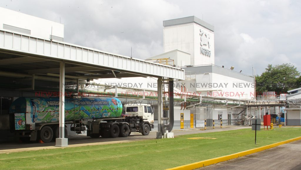 A tractor truck with special designed trail outfitted to carry fresh dairy milk collected daily from farmers nation-wide, being offload directly into the factory inlet tubes at Nestle's Valsayn campus. - ROGER JACOB