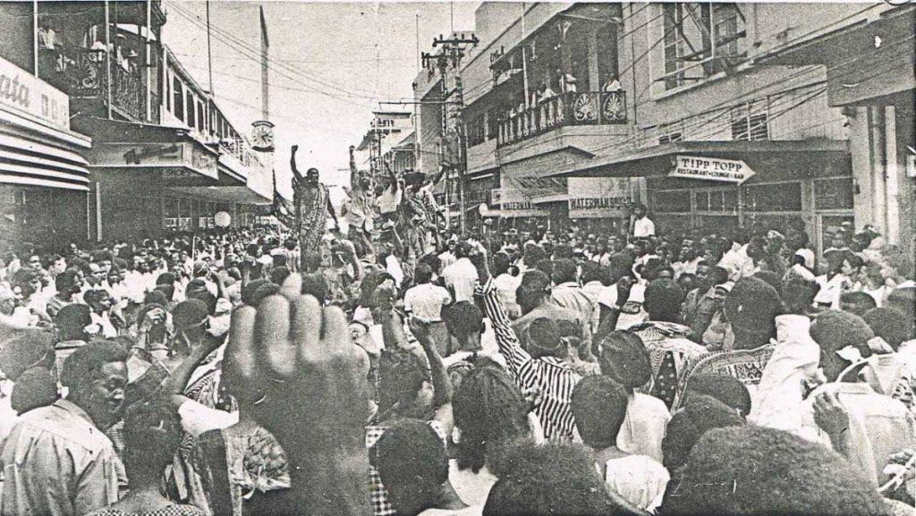 A newspaper clipping of scenes from the 1970 Black Power Revolution shows protesters swarming Frederick Street, Port of Spain.  The Black Power Movement was discussed by TT writers in the Revolution Time segment of the NGC Bocas Lit Fest last weekend. -