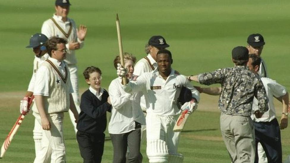Brian Lara (centre) is mobbed by the crowd after setting the new world record, 501 not out, for Warwickshire against Durham. -