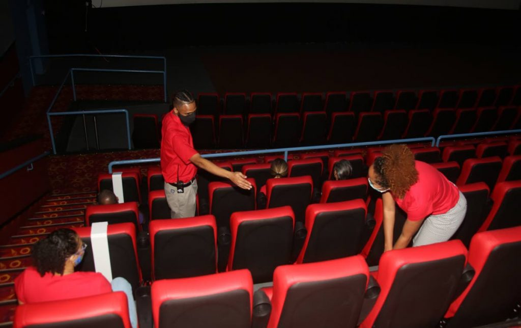 SAFE DISTANCE: Staffers of MovieTowne ensure that patrons are seated in a manner as to maintain covid19 social distancing protocol before the start of a movie. - SUREASH CHOLAI