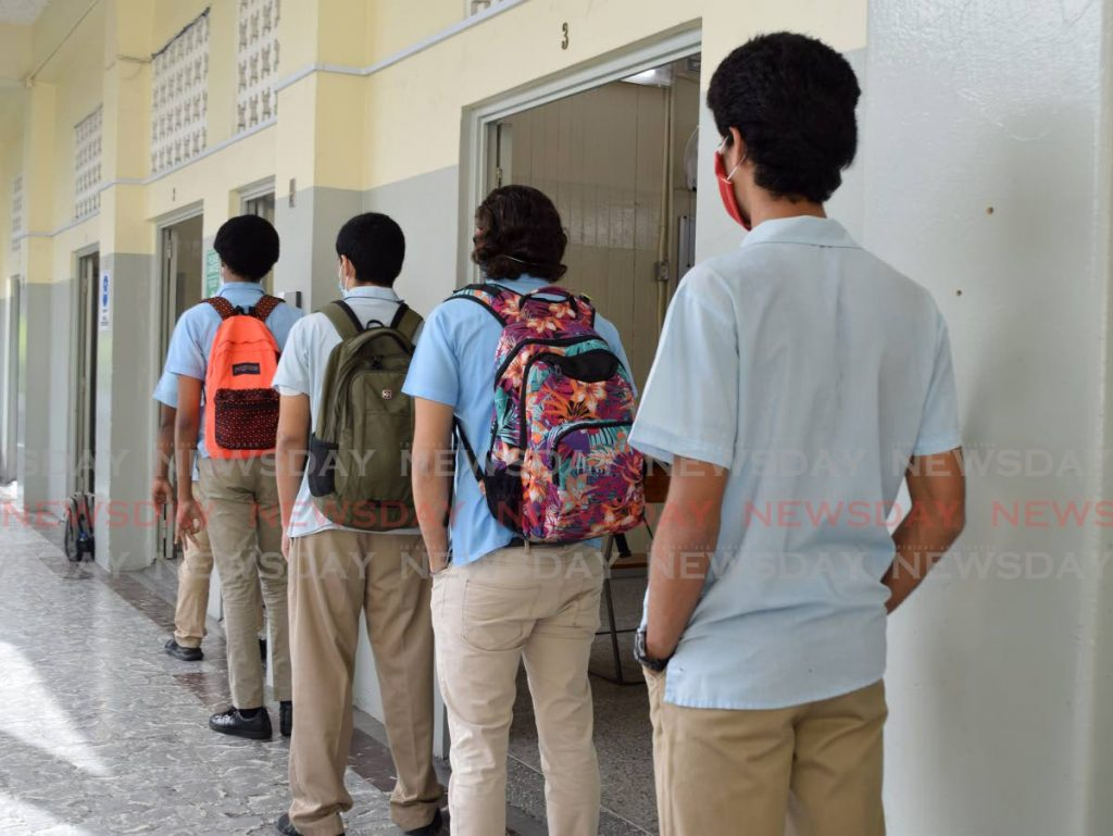In this July 14, 2020 file photo St Mary's College students wait to enter a classroom for a CAPE exam in compliance with covid19 health guidelines. St Mary's is one of the schools that is querying the 2020 CXC results. - Vidya Thurab