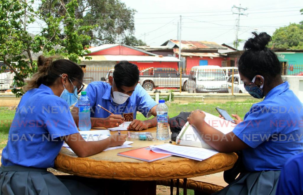 In this July 15, 2020 file photo, sixth form students of Hillview College, Tunapuna revise for an exam. Ayanna Kinsale