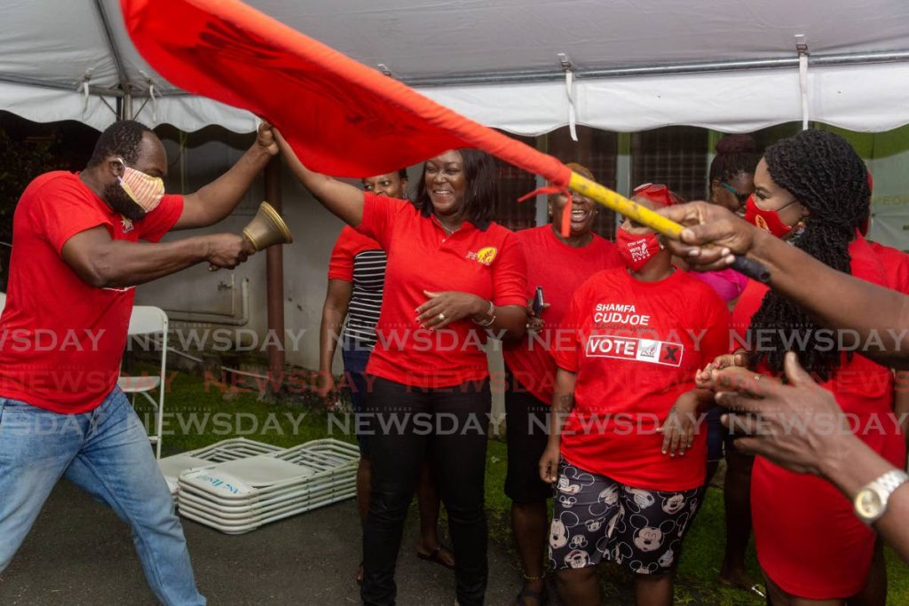 FILE PHOTO: PNM Tobago Council leader Tracy Davidson-Celestine, second from left, and Tobago West MP Shamfa Cudjoe celebrate, right, celebrate victory at PNM headquarters in Scarborough after the August 10 general election. -
