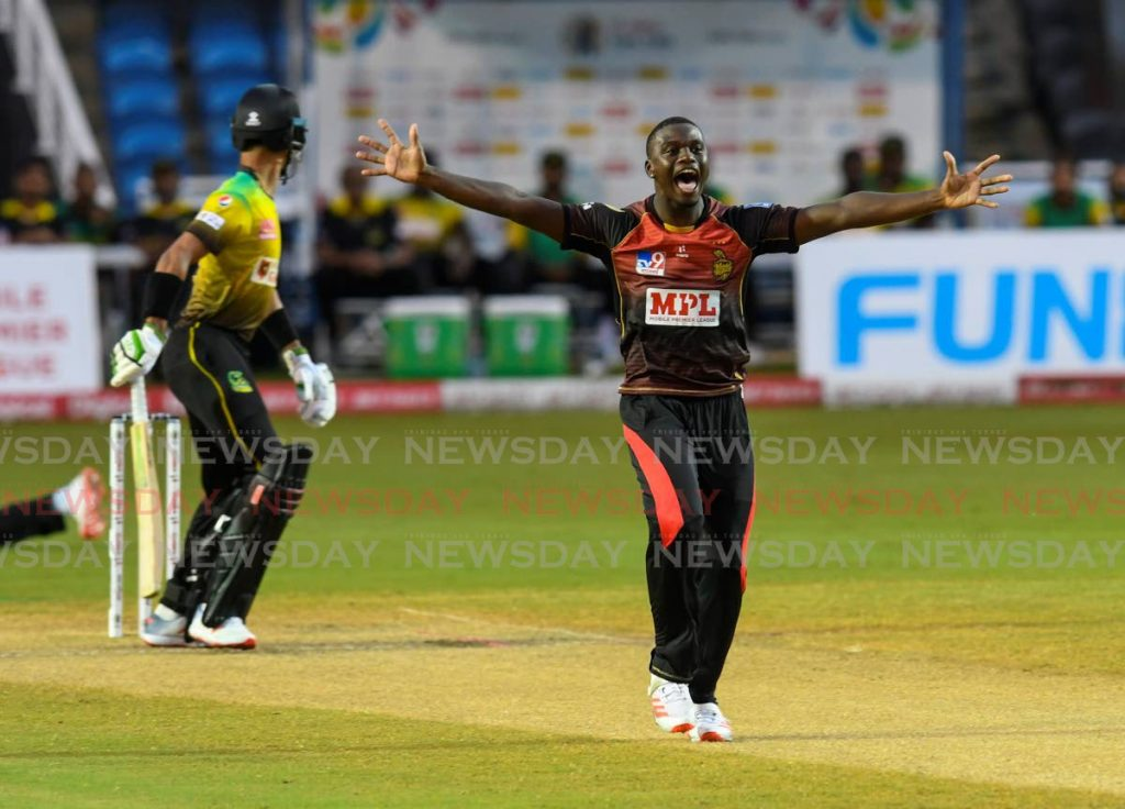 In this August 20 file photo, Jayden Seales (right) of Trinbago Knight Riders successfully appeals for the dismissal of Nicholas Kirton of Jamaica Tallawahs during the Hero Caribbean Premier League match 6 between Trinbago Knight Riders and Jamaica Tallawahs at Brian Lara Cricket Academy on  in Tarouba. (Photo by CPL T20 via Getty Images) -