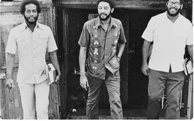 """Grenada prime minister Maurice Bishop, centre, and two of the """"comrades"""" who voted to """"execute"""" him on October 19, 1983 – Selwyn Strachan (left) and Bernard Coard (right). -"""