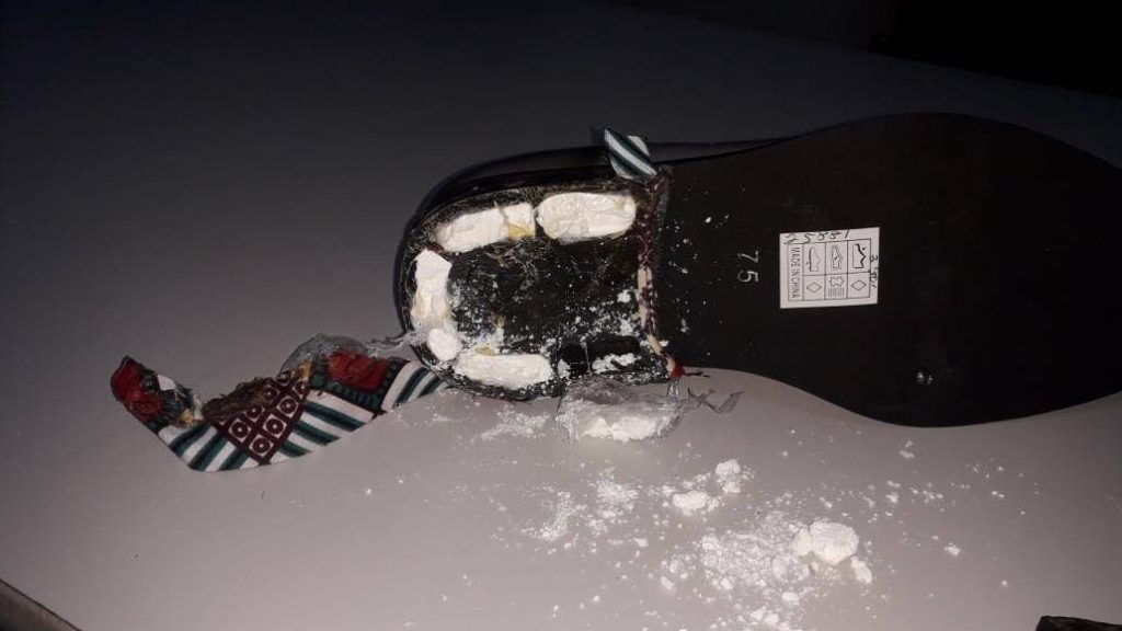 One side of the pair of men's shoes in which cocaine was found.     - TTPS