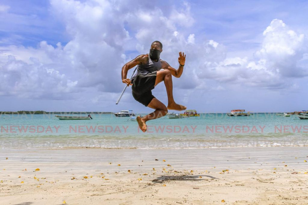 In this October 2 file photo, lifeguard Andre Jemmott practises martial arts at Buccoo beach, Tobago. Beaches will reopen in Trinidad and Tobago on Monday. PHOTO BY AYANNA KINSALE