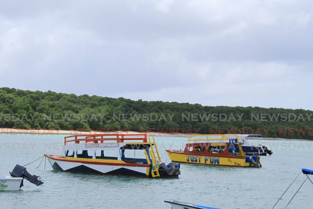 Glass bottom boats anchored at Buccoo beach in Tobago will set out on tours soon as Government approves the reopening of the marine park. PHOTO BY AYANNA KINSALE -