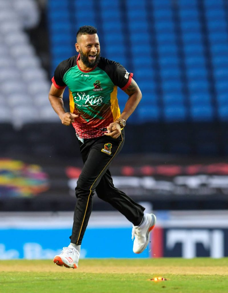 In this August 18 file photo, St Kitts & Nevis Patriots captain Rayad Emrit celebrates the dismissal of Kyle Mayers of Barbados Tridents during the Hero Caribbean Premier League match 2, at Brian Lara Cricket Academy, Tarouba. - CPL T20 via Getty Images