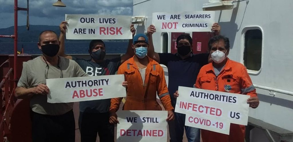 Crew members of the Star Balboa protest against their continued detention. -