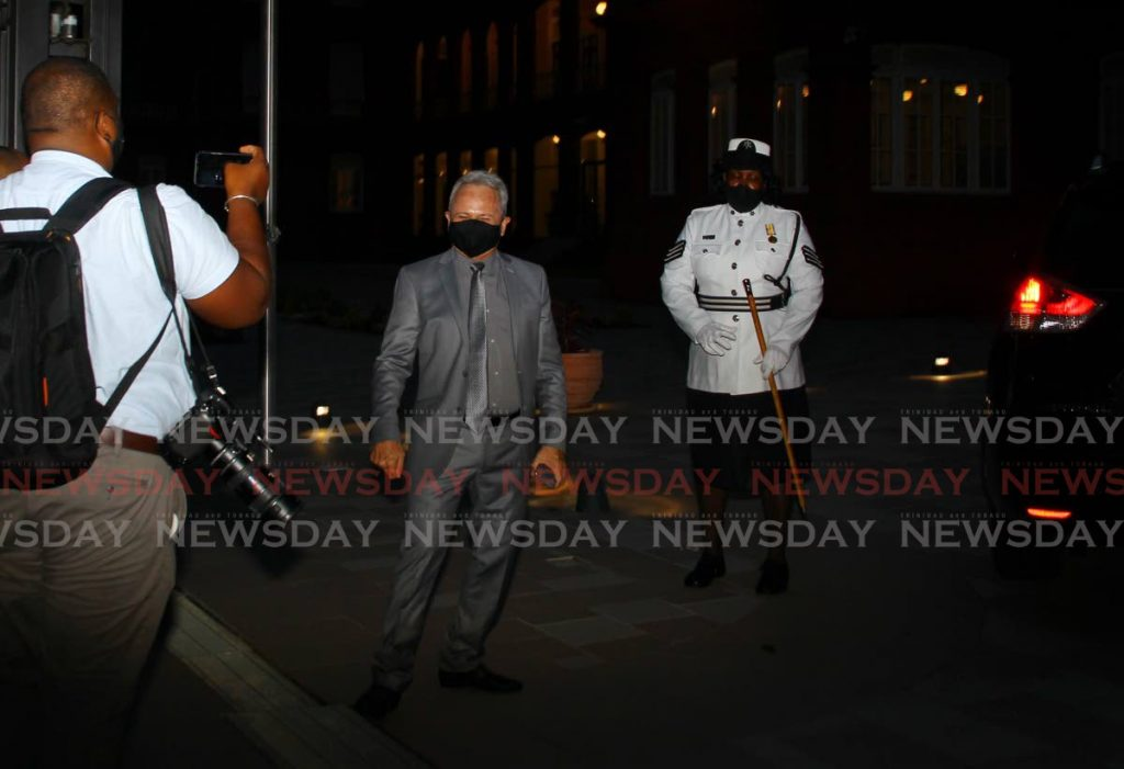 LOOK AT ME: Finance Minister Colm Imbert stands in darkness outside the Red House as a photographer takes his photo on Monday evening. PHOTO BY ROGER JACOB -