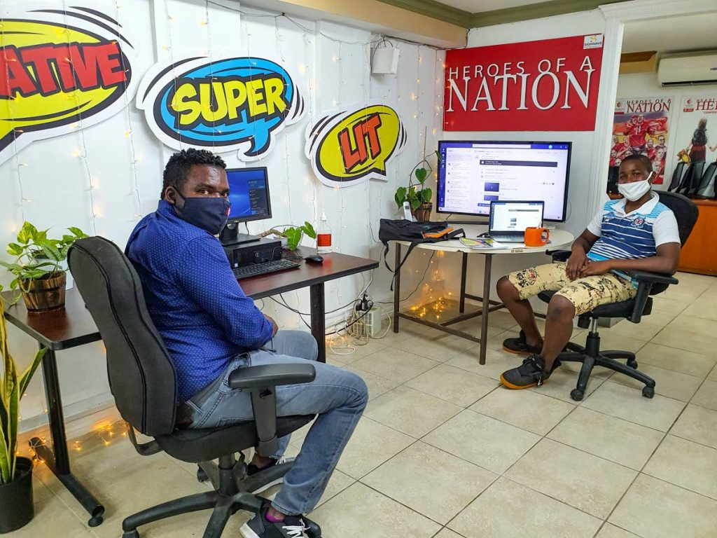 Heroes technology co-ordinator, Keiron McDowall, left, and a student from Belmont Secondary School in the Heroes Student Support Centre in October. -