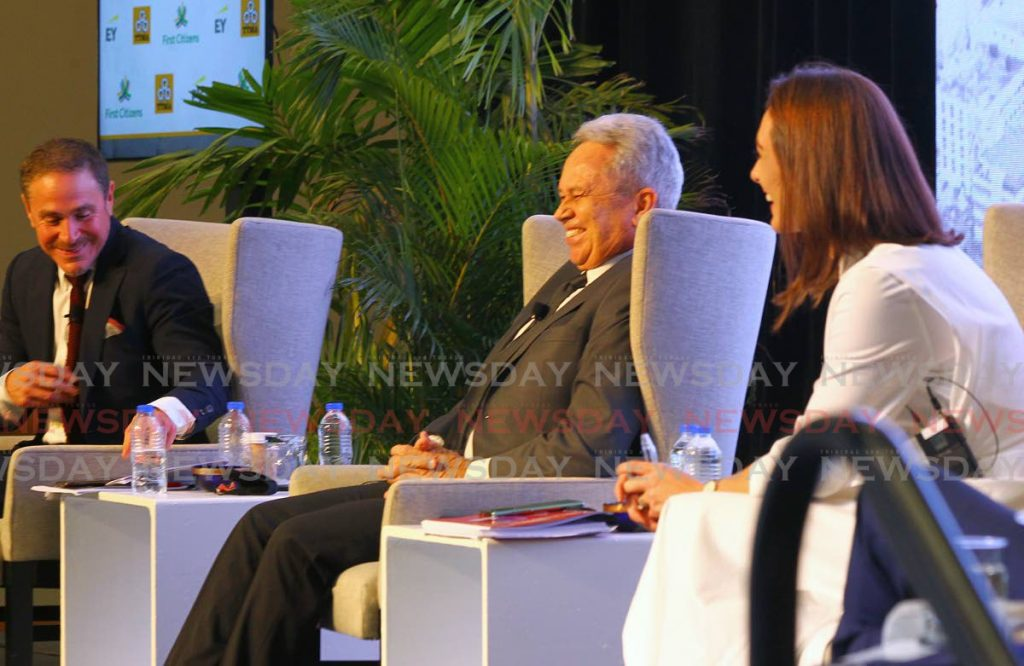 HEARTY LAUGH: Finance Minister Colm Imbert shares a laugh with Wade George, left, and TTMA president Franka Costelloe on Tuesday at the Hyatt Regency in Port of Spain.  PHOTO BY ROGER JACOB - ROGER JACOB