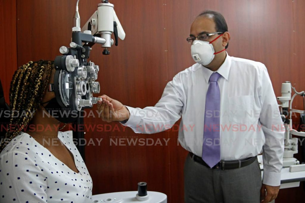 Brent Khan tests a patient's last Wednesday at his Ideal Vision Optical Ltd, lower High Street, San Fernando  - MARVIN HAMILTON