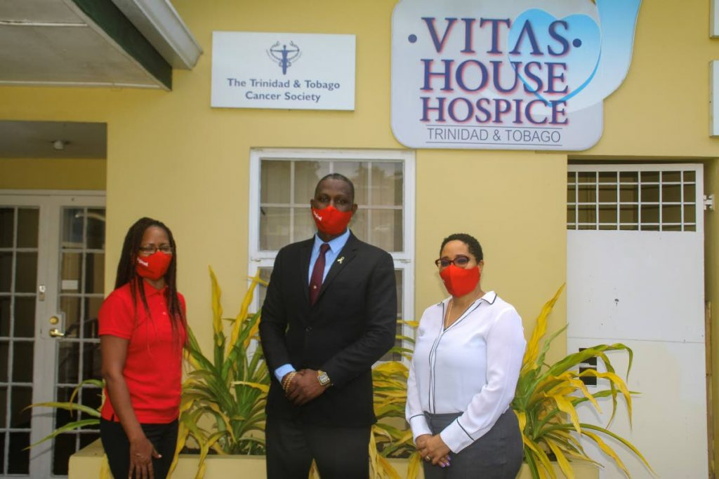 Alicia Hospedales, strategic partnership officer of Digicel Foundation, left, Kevin Cox, general manager of Vitas House Hospice and the Cancer Society of TT and Dr Asante Van West-Charles-Le Blanc, chairman of the Vitas House Hospice board at the hospice's compound. -