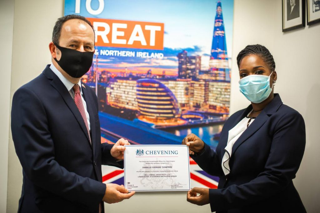 Former UK High Commissioner Tim Stew presents Danielle Thompson with her Chevening Award 2020 -