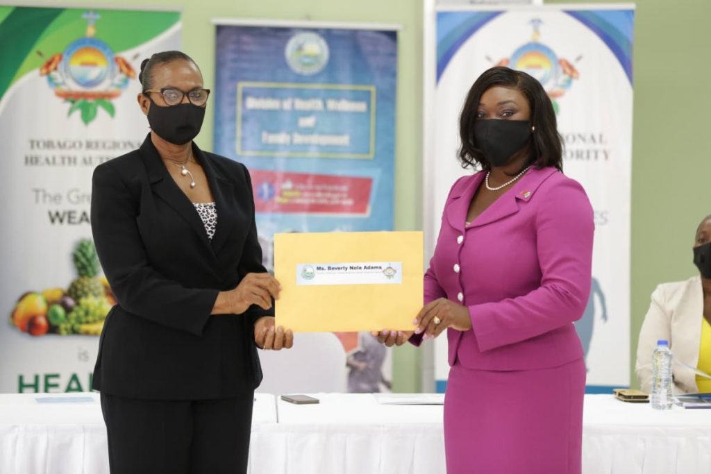 New TRHA board deputy chairman Beverly Nola Adams, left, receives her instrument of appointment from Health Secretary Tracy Davidson-Celestine on Monday. PHOTO COURTESY DIVISION OF HEALTH -