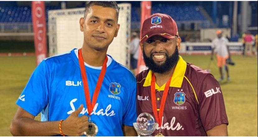 West Indies Emerging Players staff Dinesh Mahabir (performance analyst) celebrates the team's 2019 Colonial Life Medical Insurance Super 50 title win with skipper Yannick Cariah.   -