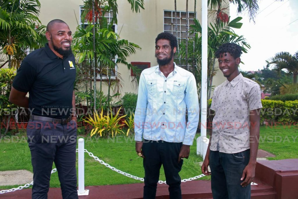Voice of the Youth CEO Makell Baptiste, left, with two of his mentees Antonio Jumratti, centre, and Khadeem Wallace. - CHEQUANA WHEELER