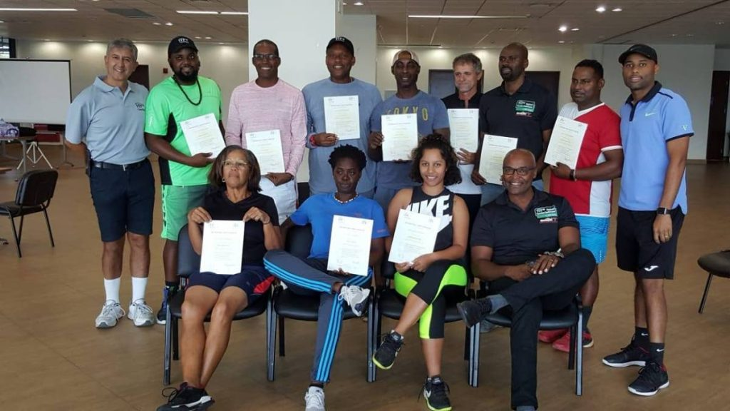 Tennis coaches from TT, Guyana, Suriname and Grenada show off their Level II certification at the National Racquet Centre in Tacarigua in 2019.  -