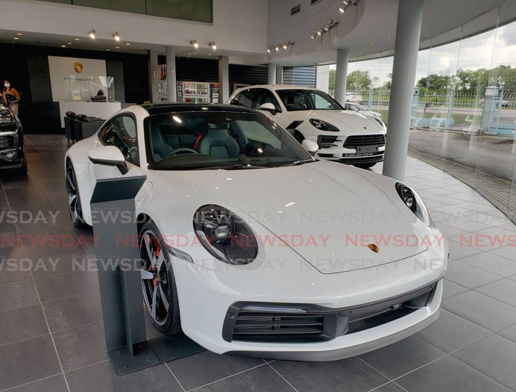 The Porsche 911 Turbo S, one of the world's  celebrated  premium luxury brands in the Porsche showroom at Lifestyle Motors, costs about  $2.2 million. - ROGER JACOB