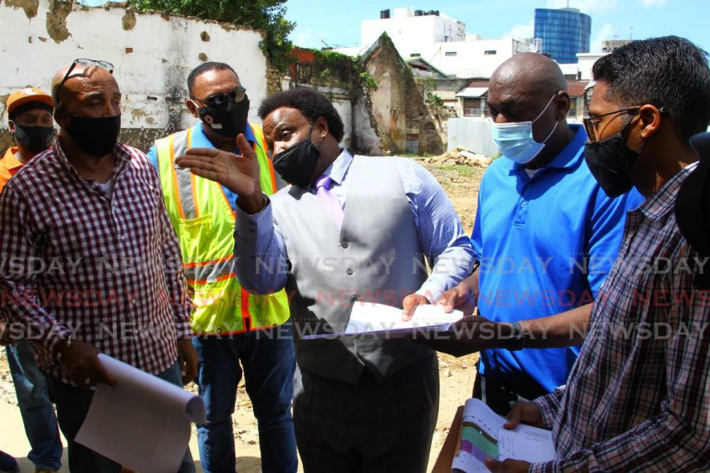 AROUND SO: PoS South MP Keith Scotland speaks with Despers' transitional team leader Finbar Fletcher, Udecott senior project manager Terrence Beepath, councillor for South PoS Dennis Bristol and Udecott senior architect Marlon Charles on Friday. - ROGER JACOB