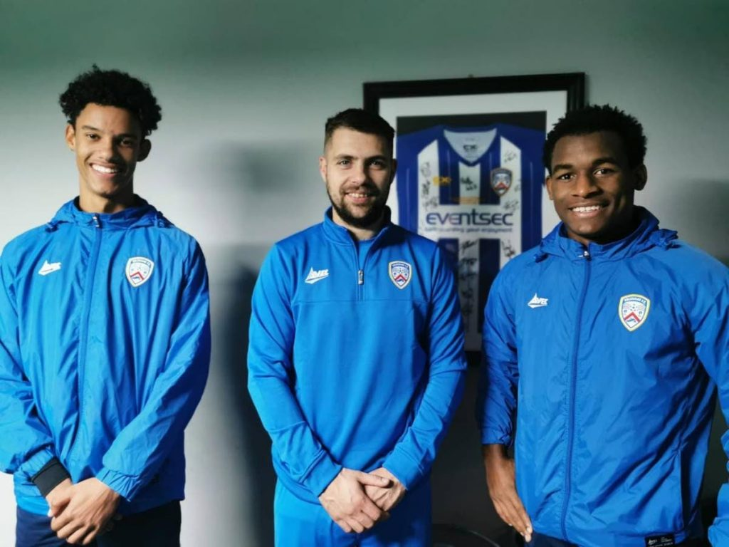 Gary Griffith III (left), fellow TT youth player Jesse Williams (right) and Coleraine FC teammate James McLaughlin. PHOTO COURTESY GARY GRIFFITH III FACEBOOK PAGE. -