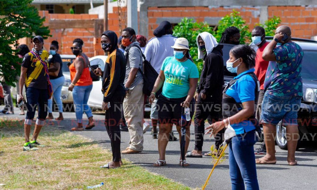 Crowds near Shepherd's Inn in Tobago looking to invest in the Drugs Sou Sou. - David Reid