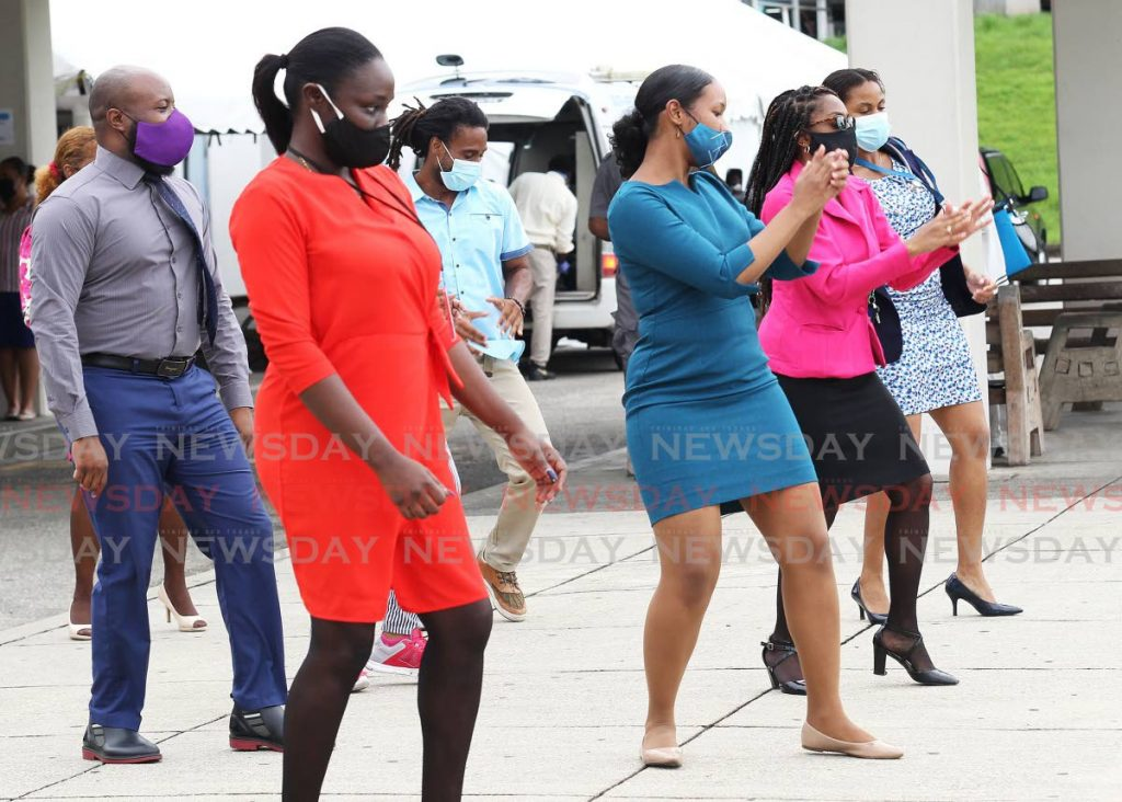Members of the San Fernando General Hospital, including doctors, nurses, clinicians alongside administrative staff, have taken the jerusalema dance challenge showing off their skills outside the emergency department  at the hospital.  Photos by Lincoln Holder