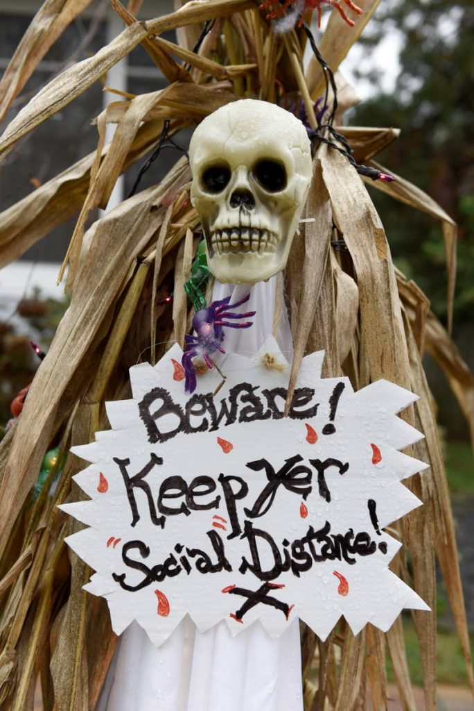 Halloween decorations are seen at the home of Carol McCarthy, reminding people to be safe while trick-or-treating during the covid19 pandemic, Monday in Palmyra, New .Jersey.  - AP Photo