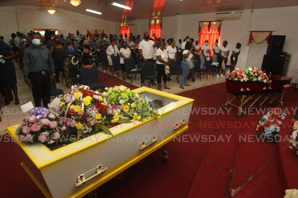 The coffins of siblings Natasha Sylverton and Linton Silverton during a funeral on Wednesday.  - Lincoln Holder