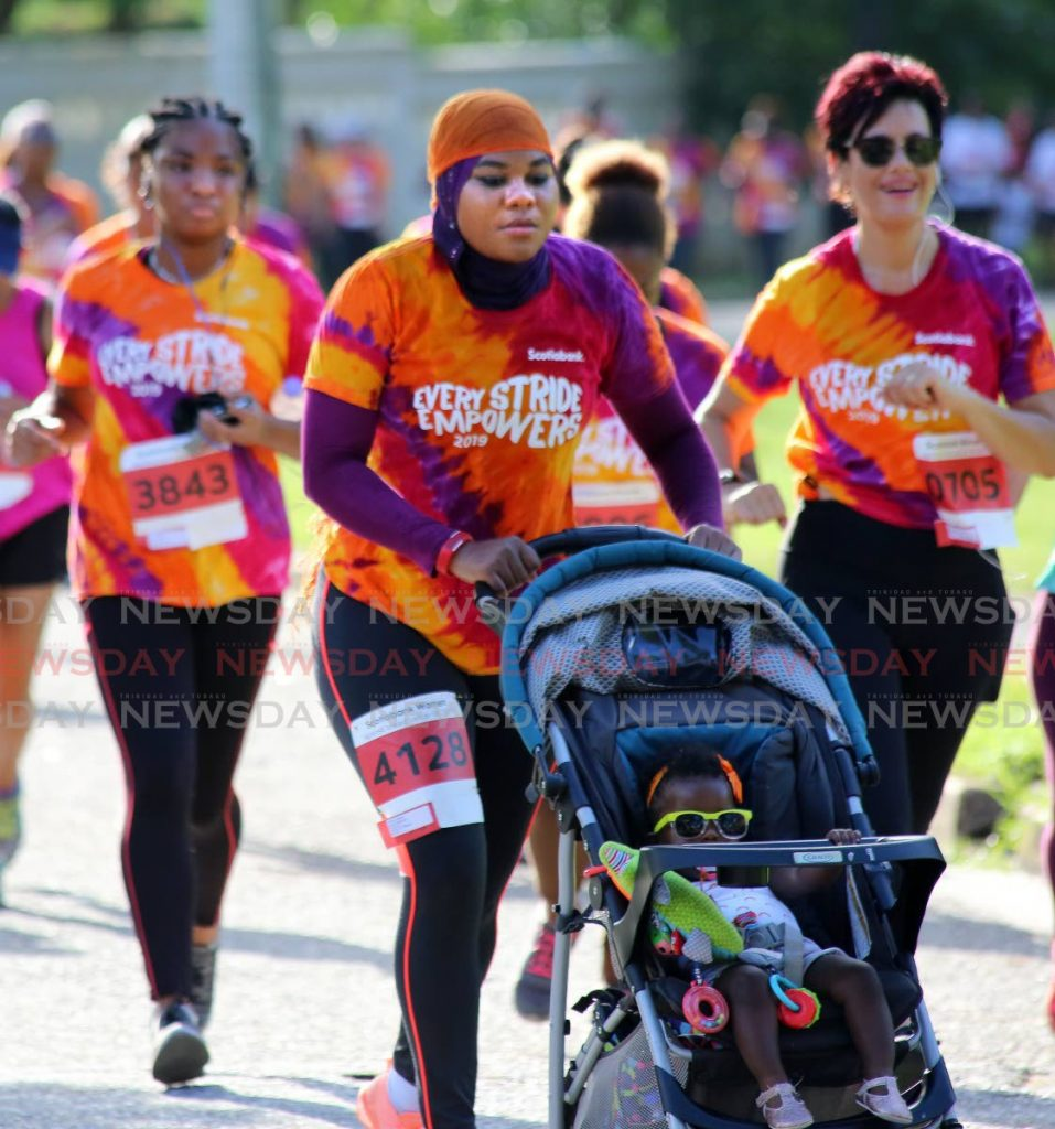 FILE PHOTO: A woman with her child in pram takes part in the 2019 Scotiabank Women Against Breast Cancer 5K at the Queen's Park Savannah in Port of Spain. The event will be held virtually on Saturday.  -
