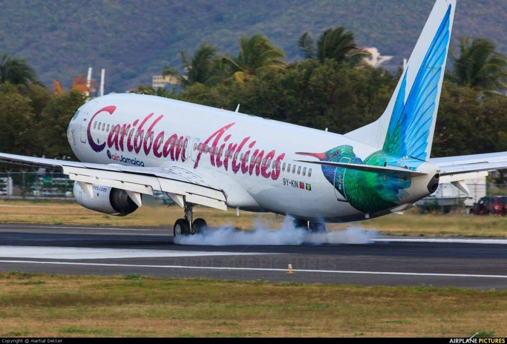 A Caribbean Airlines plane takes off.