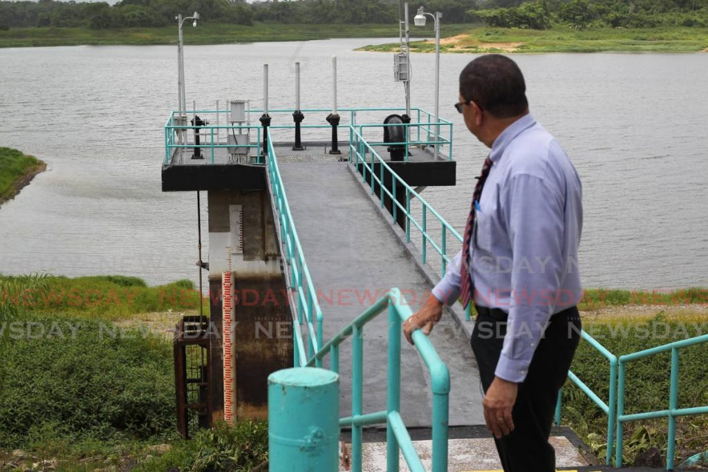 In this July 16, 2020 file photo WASA CEO Alan Poon King views the water level at the Arena reservoir.