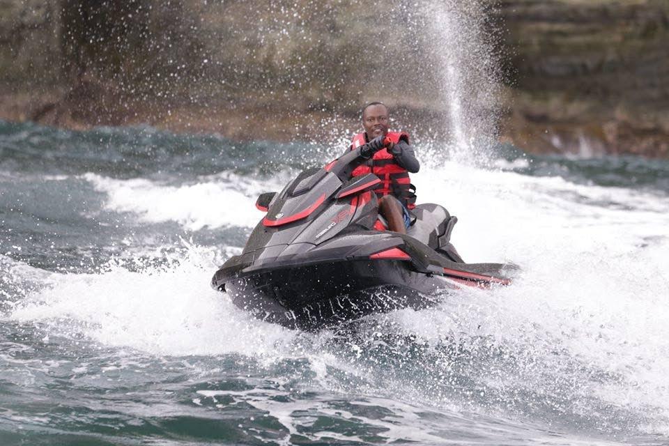 Chief Secretary Ancil Dennis on a jet ski in July. PHOTO COURTESY THA -